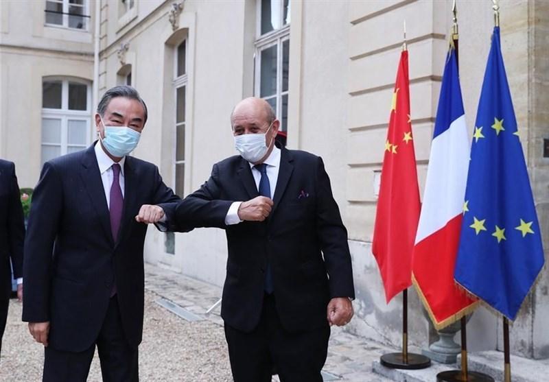وزیر خارجه چین در فرانسه بر لزوم حمایت از برجام تاکید نمود